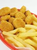 Fritture & pepite di pollo Immagini Stock