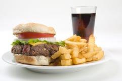 Fritture dell'hamburger e uno schiocco di soda Fotografie Stock