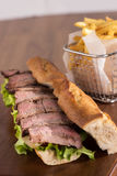 Fritture fritte eith gastronomico del panino della carne Fotografie Stock
