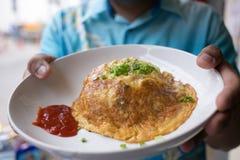 Fritura de la tortilla del huevo Fotos de archivo