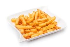 Fritures de pomme de terre avec le ketchup sur le fond blanc Images libres de droits