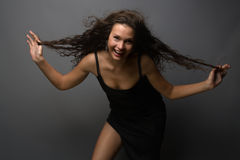 Frivolity. Portrait of frivolous beautiful girl with long hair Stock Photography