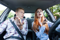Frivolous woman making up in car Royalty Free Stock Image