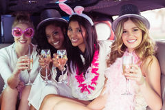 Frivolous women drinking champagne in a limousine Royalty Free Stock Images