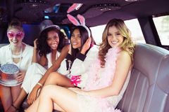 Frivolous women in a limousine Stock Photography