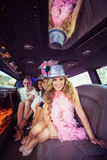 Frivolous women in a limousine Stock Photos