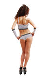 Frizzy girl in erotic clothes from behind. Royalty Free Stock Images