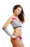 Frizzy girl in polka dot erotic clothes with bows Royalty Free Stock Photo