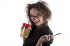 Frizzy Haired Girl Holding Peanut Butter and Knife Stock Image