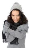 Frío hermoso de la mujer en invierno Imagen de archivo libre de regalías