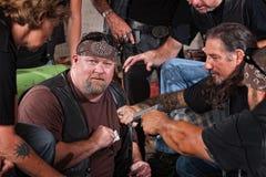 Frode catturata membro del gruppo del motociclista Fotografia Stock