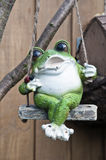 Frog. Decaration frog swings and sing Royalty Free Stock Photos