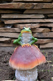 Frog figurine. Ceramic green frog on mushroom Stock Image