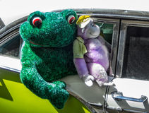 Frog and gorilla take a ride Stock Photo