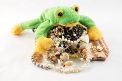 Frog and jewellery Royalty Free Stock Photography