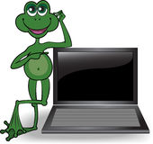 Frog leaned on the computer Stock Photo