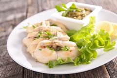 Frog leg with parsley and salad Royalty Free Stock Images