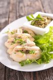 Frog leg with parsley and salad Stock Photography