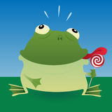 Frog and lollipop Stock Photos