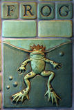 Frog Lover. Closeup of a ceramic tile depicting a frog with a crown Royalty Free Stock Photos