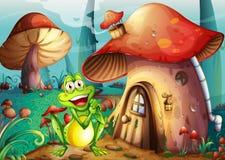 A frog near the mushroom house Stock Image
