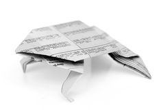Frog origami from newspaper isolated. On white background royalty free stock image