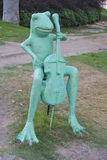 Frog plays the violin Stock Photo