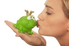 Frog price being kissed by a beautiful lady Stock Image