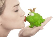 Frog price being kissed by a beautiful lady Stock Photography