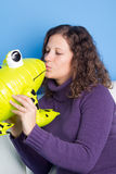Frog prince being kissed Royalty Free Stock Image