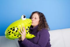 Frog prince being kissed Stock Photography