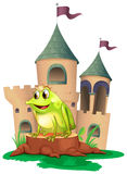 A frog prince with a castle at his back Stock Photos