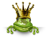 Frog prince with gold crown holding a blank sign Royalty Free Stock Image