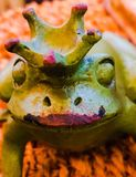 The Frog Prince. An up close photo of the statue of a green frog prince with crown royalty free stock photo