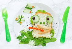 Frog sandwich. Made from bread, green salad and cucumber royalty free stock photography