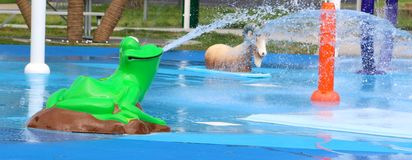 Frog and Sheep Spraying Water At A  City Splash Park Royalty Free Stock Image
