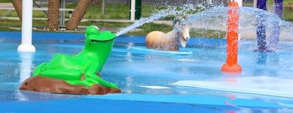 Frog and Sheep Spraying Water At A  City Splash Park Royalty Free Stock Image
