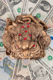 The frog is sitting on the money. The money toad on the dollar and the euro. Feng Shui Royalty Free Stock Images