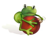 Frog sitting on xmas ball Royalty Free Stock Photo