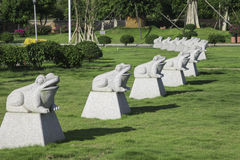 Frog statues. In a line,garden landscape Stock Photos