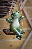 Frog on a swing Royalty Free Stock Images