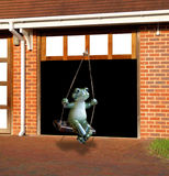 Frog swinging from garage door Stock Photos