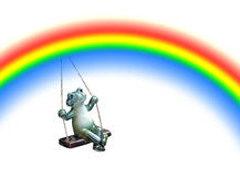Frog swinging on a rainbow. Concept photo of a frog swinging on a rainbow on white background ideal for text etc Stock Images