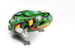 Frog tin toy on white background Stock Images