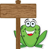 Frog with wooden banner Stock Images