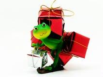 Froggy el repartidor del regalo Imagenes de archivo