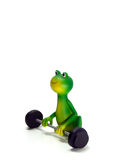 Froggy, green frog character, the powerlifter. Miniature featuring a frog with a barbell isolated on white background Royalty Free Stock Photo