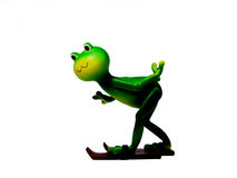 Miniature frog figurine with skis Stock Images