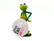 Froggy works from home. Froggy displaying a sign inviting people to work from home Stock Images