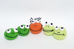 Frogs. Balls of wool dolls that look like frogs Royalty Free Stock Photo